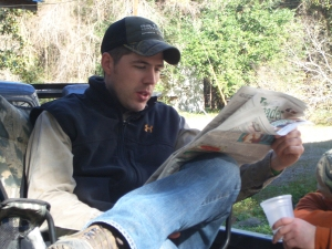 James Guthrie, reading The Oconee Leader. This may be the closest thing to a photo of the two of us together.
